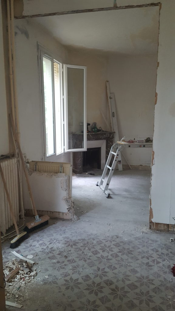 Renovate an old house - knock down a wall to create a big living space with kitchen and living room